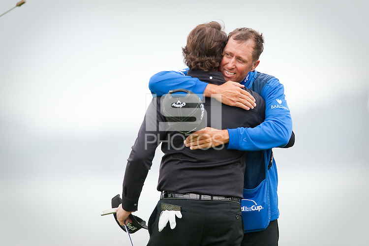 PEBBLE BEACH, CA--Phil Mickelson is congratulated by caddy Bones Mackay after winning the AT&T Pebble Beach National Pro-Am Golf Championship at Pebble Beach Golf Links in Pebble Beach, CA on Sunday, February 12, 2012. Mickelson won the tournament with a total score of 269.