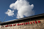 Club signage on the main stand at Broadhurst Park, Manchester, the new home of FC United of Manchester, pictured before the club's match against Benfica, champions of Portugal, which marked the official opening of their new stadium. FC United Manchester were formed in 2005 by fans disillusioned by the takeover of Manchester United by the Glazer family from America. The club gained several promotions and played in National League North in the 2015-16 season, but lost this match 1-0.
