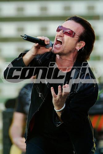 U2 - vocalist Bono performing live on the Vertigo World Tour at Twickenham Stadium Twickenham UK - 18 Jun 2006 - Photo by: George Chin