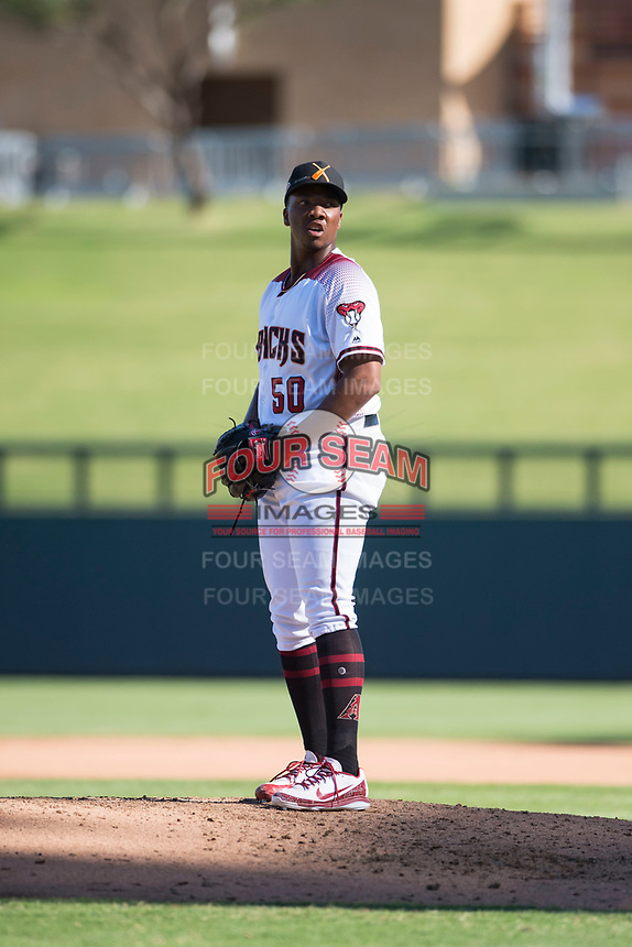 Salt River Rafters relief pitcher Tyler Mark (50), of the Arizona Diamondbacks organization, gets ready to deliver a pitch during an Arizona Fall League game against the Surprise Saguaros at Salt River Fields at Talking Stick on November 5, 2018 in Scottsdale, Arizona. Salt River defeated Surprise 4-3 . (Zachary Lucy/Four Seam Images)