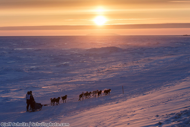 Mark Selland on the trail a few miles from Nome at sunset on Saturday March 21, 2015 during Iditarod 2015.  <br /> <br /> (C) Jeff Schultz/SchultzPhoto.com - ALL RIGHTS RESERVED<br />  DUPLICATION  PROHIBITED  WITHOUT  PERMISSION