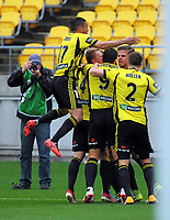 Phoenix players celebrate Dario Vidosic's goal during the A-League football match between Wellington Phoenix and Adelaide United FC at Westpac Stadium in Wellington, New Zealand on Sunday, 8 October 2017. Photo: Dave Lintott / lintottphoto.co.nz