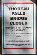 "May 23, 2018 - Thoreau Falls Trail bridge closed sign. The Thoreau Falls Trail bridge, which crosses the East Branch of the Pemigewasset River, in the Pemigewasset Wilderness is not safe and is out of service. The trail is still open, but hikers will have to ford the river at this location. The sign states: ""Do not plan to use the Thoreau Falls Trail bridge as it has been partially decommissioned to prevent use in its current condition. Hikers must exercise good judgment and should have contingency plans in case fording the river at this location is not possible."""