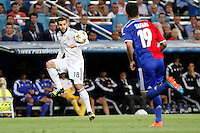 Nacho of Real Madrid and Samuel of FC Basel 1893 during the Champions League group B soccer match between Real Madrid and FC Basel 1893 at Santiago Bernabeu Stadium in Madrid, Spain. September 16, 2014. (ALTERPHOTOS/Caro Marin) /NortePhoto.com