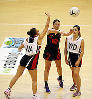 29.09.2014 Eastern Waikato's Carissa Te Wharau in action during the  Counties Manukau v Eastern Waikato duing the Lion Foundation Netball Champs at the Trusts Stadium in Auckland. Mandatory Photo Credit ©Michael Bradley.