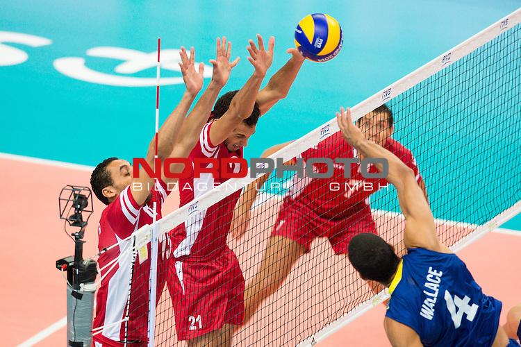 03.09.2014, Spodek, Kattowitz<br /> Volleyball, FIVB Volleyball Men`s World Championship 2014, Brasilien (BRA) vs. Tunesien (TUN)<br /> <br /> Block / Doppelblock Hichem Kaabi (#15 TUN), Nabil Miladi (#21 TUN) - Angriff Wallace de Souza (#4 BRA)<br /> <br />   Foto &copy; nordphoto / Kurth