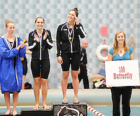 Sauk Prairie's Alison Meng sets a state record in the 100 butterfly in the WIAA Division 2 state girls swimming meet. Monona Grove's Kelsey Millin (to her left) takes 2nd place