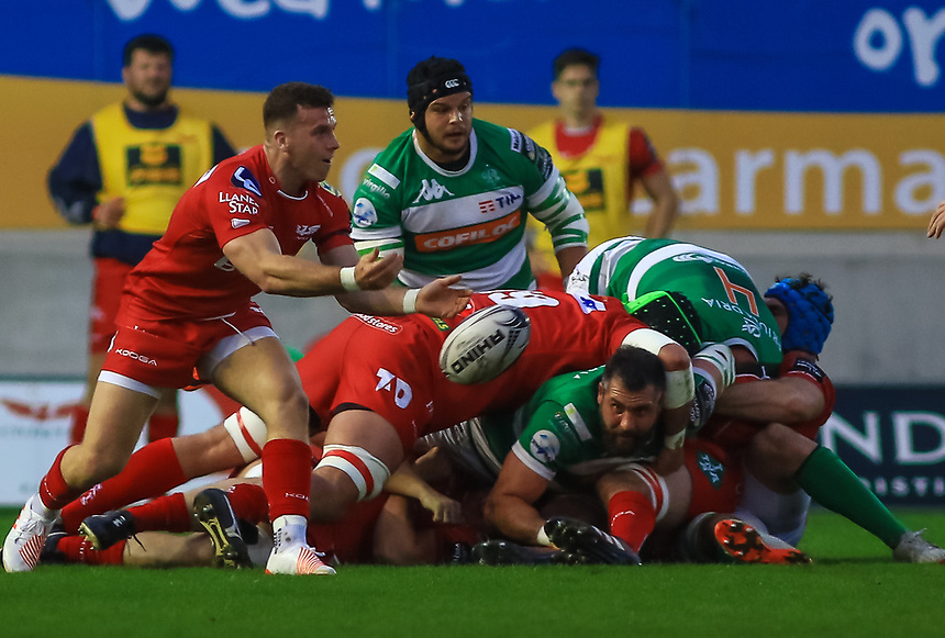 Scarlets' Gareth Davies passes the ball away from the base of a ruck.<br /> <br /> Photographer Dan Minto/CameraSport<br /> <br /> Guinness PRO12 Round 18 - Scarlets v Edinburgh Rugby - Friday 24th March 2017 - Parc y Scarlets - Llanelli<br /> <br /> World Copyright &copy; 2017 CameraSport. All rights reserved. 43 Linden Ave. Countesthorpe. Leicester. England. LE8 5PG - Tel: +44 (0) 116 277 4147 - admin@camerasport.com - www.camerasport.com