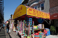 A store sells chinese wares on 86th Street by the Brooklyn elevated subway in the New York City borough of Brooklyn, NY, Sunday July 31, 2011. Bensonhurst is a neighborhood located in the south-western part of the New York City borough of Brooklyn with important italian-american and Chinese community.