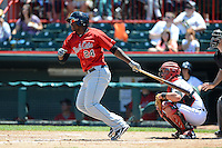 New Britain Rock Cats third baseman Miguel Sano #24 at bat in front of catcher James McCann during a game against the Erie Seawolves on June 20, 2013 at Jerry Uht Park in Erie, Pennsylvania.  New Britain defeated Erie 2-0.  (Mike Janes/Four Seam Images)