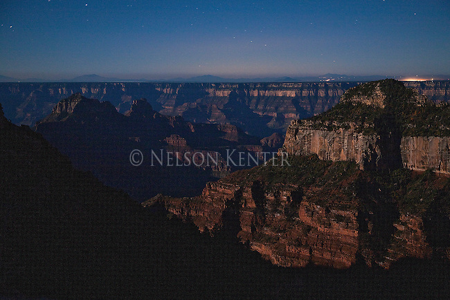 Long exposure after dark of the Grand Canyon looking across from the north rim to the visible lights of Grand Canyon Village on the south rim.