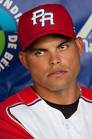 9 March 2009: #7 Ivan Rodriguez of Puerto Rico is seen in the dugout prior to the 2009 World Baseball Classic Pool D game 4 at Hiram Bithorn Stadium in San Juan, Puerto Rico. Puerto Rico wins 3-1 over Netherlands