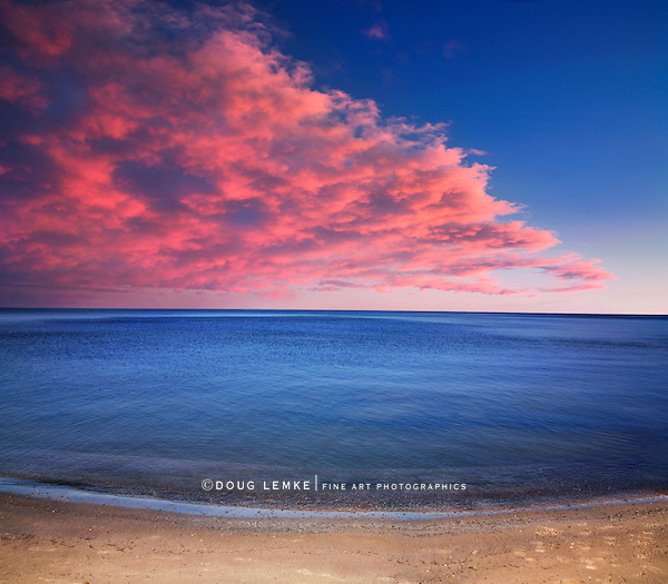 A Sparse And Minimalistic Image Of A Blazing Sunset Over The Calm Waters Of Lake Erie Near Vermilion Ohio, USA