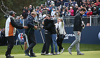 Matthew Fitzpatrick (ENG) joined by brother and mother on the 18th to celebrate winning the Final Round of the British Masters 2015 supported by SkySports played on the Marquess Course at Woburn Golf Club, Little Brickhill, Milton Keynes, England.  11/10/2015. Picture: Golffile | David Lloyd<br /> <br /> All photos usage must carry mandatory copyright credit (&copy; Golffile | David Lloyd)