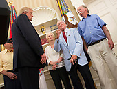 U.S. President Donald J. Trump listens to Donald Stratton(2nd right), a survivor of the attack on the USS Arizona speak while visiting with survivors from the USS Arizona at The White House in Washington, DC, July 21, 2017.<br /> Credit: Chris Kleponis / Pool via CNP
