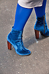 Blue suede shoes worn by a woman walking in the Easter Parade in New York City