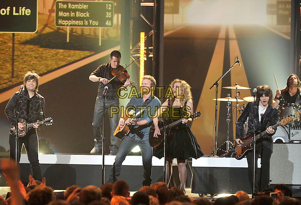 Dierks Bentley, Kimberly Perry, Reid Perry, Neil Perry, The Band Perry .The Grammy Nominations Concert Live, held at Bridgestone Arena,Nashville, Tennessee, USA, 5th December 2012..music grammys  half length playing gig show black dress  guitar  microphone singing .CAP/ADM/FB.©Frederick Breedon/AdMedia/Capital Pictures.