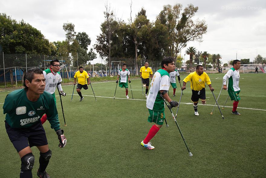 """Players from Guerreros Aztecas and Los Dragones (""""the Dragons"""") anticipate a high pass during a match in Mexico City, Mexico on July 5, 2014. Guerreros Aztecas (""""Aztec Warriors"""") is Mexico City's first amputee football team. Founded in July 2013 by five volunteers, they now have 23 players, seven of them have made the national team's shortlist to represent Mexico at this year's Amputee Soccer World Cup in Sinaloathis December.The team trains twice a week for weekend games with other teams. No prostheses are used, so field players missing a lower extremity can only play using crutches. Those missing an upper extremity play as goalkeepers. The teams play six per side with unlimited substitutions. Each half lasts 25 minutes. The causes of the amputations range from accidents to medical interventions – none of which have stopped the Guerreros Aztecas from continuing to play. The players' age, backgrounds and professions cover the full sweep of Mexican society, and they are united by the will to keep their heads held high in a country where discrimination against the disabled remains widespread.(Photo byBénédicte Desrus)"""
