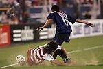 24 July 2007:  Juan Toja (8) of FC Dallas slide tackles the ball away from Roberto Rivera (18) of CD Gaudalajara.  FC Dallas tied Chivas de Guadalajara 1-1 at Pizza Hut Park in Frisco, Texas, in the opening match of SuperLiga 2007.