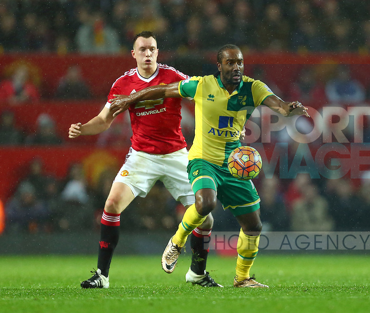 Phil Jones of Manchester United and Norwich's Cameron Jerome - Manchester United vs Norwich City - Barclays Premier League - Old Trafford - Manchester - 19/12/2015 Pic Philip Oldham/SportImage