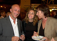 German film maker Christoph Schaub (L)  and French actress Emanuelle Beart (M) who is the President of the 25th  World Film Festival's  Jury pose  for a photo<br /> with an unidentified woman (R)   at  the Party of the German Delegation , August 26th, 2001<br /> in Montreal, CANADA<br /> <br /> Brought up on a farm in Provence because her father, French singer and poet Guy BÈart didn't want her to be affected by the glamour world of Paris showbusiness, Emmanuelle BÈart nevertheless got the acting urge in early adolescence. At age 15, after a couple of bit parts, she came to Montreal as an au pair to learn English. Back in France, after acting lessons and few small roles in television, she made her big-screen breakthrough in the title role of Claude Berri's Pagnol adaptation, MANON OF THE SPRING (1986). A year later she made her Hollywood debut in Tom McLoughlin's DATE WITH AN ANGEL. She has since played for some of the premier directors on both sides of the Atlantic: Rivette (LA BELLE NOISEUSE, 1991), Sautet (NELLY AND MR. ARNAUD (1995), Chabrol (L'ENFER,1994), De Palma (MISSION: IMPOSSIBLE, 1996) and Ruiz (TIME REGAINED, 1999). She stars in Catherine Corsini's REPLAY, showing at this year's Festival.<br /> <br /> Photo by Pierre Roussel / Getty Images (On Spec)<br /> <br /> NOTE : Nikon D-1 JPEG opened with QUIMAGE ICC profile , saved as Adobe RG 1998 color space.