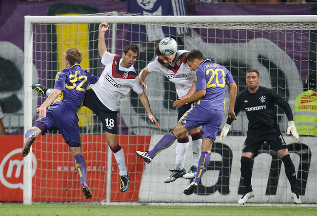 Carlos Bocanegra and Lee Wallace make a last gasp effort to deny Maribor in front of goal