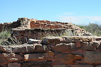 Navajo County, Arizona – Ruins at the Puerco Pueblo. The original inhabitants are believed to have lived in this area for over 13,000 years. The ruins outline dwelling's rooms within Puerco Pueblo at this Petrified Forest National Park. The Painted Desert is a broad region of rocky badlands featuring unique rocks in a variety of hues - lavenders, grays, reds, oranges and pinks. Located in Northeastern Arizona, the Painted Desert attracts hundreds of thousands a visitors each year. Photo by Eduardo Barraza © 2014