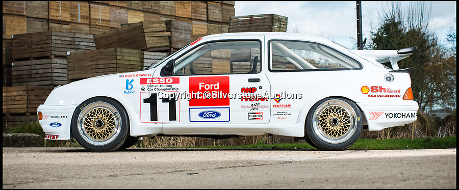 BNPS.co.uk (01202 558833)Pic: SilverstoneAuctions/BNPS<br /> <br /> The 1990 Ford Sierra RS500 Cosworth.<br /> <br /> A classic Ford coupe that won the prestigious British Touring Car Championship in 1990 has emerged for sale for a record-breaking £220,000. <br /> <br /> The Sierra RS500 Cosworth won the coveted prize in 1990 after being entered by Trackstar Racing, who were co-founded just a year earlier in 1989 by the legendary Radio 1 Breakfast DJ, Mike Smith.<br /> <br /> The team's sole ambition was to win the BTCC and after finishing runners-up in their first attempt, they took the crown home at the turn of the decade.<br /> <br /> In 1990 the car won a staggering nine out of 13 races, setting eight fastest lap records in the process. It was the final time an RS500 won the title before it was replaced by Ford the following year.<br /> <br /> Driven by Robb Gravett, the car was fitted with a new suspension, a five-speed gearbox and had a top-spec engine that produced over 500bhp.
