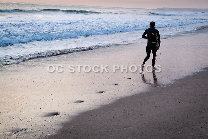 Surfer in a Wetsuit Looking for the Next Wave