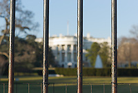 Front view of the White House through security bars