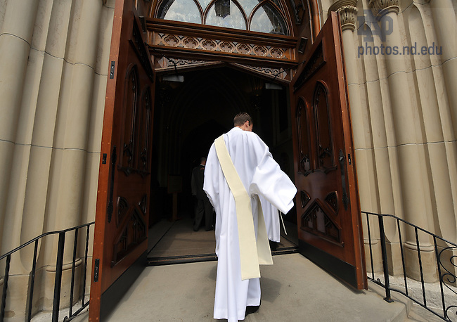 Rev. Aaron J. Michka C.S.C. enters the Basilica for Ordination, 2009..Photo by Matt Cashore/University of Notre Dame