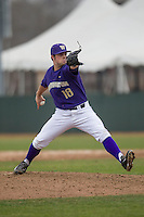 Washington Huskies pitcher Alex Nesbitt (28) delivers a pitch to the plate during the NCAA baseball game against the Michigan Wolverines on February 16, 2014 at Bobcat Ballpark in San Marcos, Texas. The game went eight innings, before travel curfew ended the contest in a 7-7 tie. (Andrew Woolley/Four Seam Images)