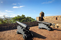 Cannons pointing out to sea at the Fortaleza San Felipe, or El Morro de San Felipe, a defensive fortress built 1564-77 to protect Puerto Plata from pirates, in Puerto Plata province, Dominican Republic, in the Caribbean. In 1983 the Museo de la Fortaleza San Felipe was opened here, containing military artefacts from the fort's history. Picture by Manuel Cohen