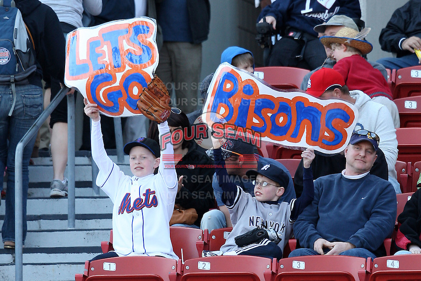April 14, 2010:  Fans hold up signs during the opening home game vs. Pawtucket at Coca-Cola Field in Buffalo, New York.  The Bisons are the Triple-A International League affiliate of the New York Mets.  Photo By Mike Janes/Four Seam Images