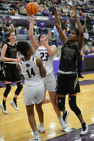 Fayetteville's Caroline Lyles (23) takes a shot Friday, Jan. 17, 2020, as she is pressured by Bentonville's Maryam Dauda (right) during the first half of play in Bulldog Arena in Fayetteville. Visit nwaonline.com/prepbball/ for a gallery from the games.<br /> (NWA Democrat-Gazette/Andy Shupe)