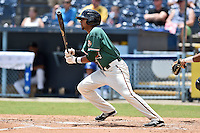 Greensboro Grasshoppers shortstop Rehiner Cordova #11 swings at a pitch during a game against the  Asheville Tourists at McCormick Field June 29, 2014 in Asheville, North Carolina. The Grasshoppers defeated the Tourists 4-0. (Tony Farlow/Four Seam Images)