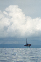 Storm clouds form above a platform standing in Cook Inlet, offshore from Nikiski, Alaska. The oil and natural gas industries are an important contributor to the Kenai Peninsula's economy.