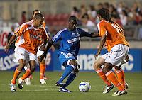 Kansas City's Eddie Johnson attempts to dribble the ball around Houston's Adrian Serioux (R) at Robertson Stadium in Houston, TX on Saturday April 8, 2006.  Kansas City beat Houston 2-1.