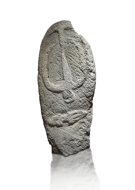 Late European Neolithic prehistoric Menhir standing stone with carvings on its face side. The representation of a stylalised male figure starts at the top with a long nose from which 2 eyebrows arch around the top of the stone. below this is a carving of a falling figure with head at the bottom and 2 curved arms encircling a body above. at the bottom is a carving of a dagger running horizontally across the menhir.  Excavated from Barrili II site,  Laconi. Menhir Museum, Museo della Statuaria Prehistorica in Sardegna, Museum of Prehoistoric Sardinian Statues, Palazzo Aymerich, Laconi, Sardinia, Italy. White background.