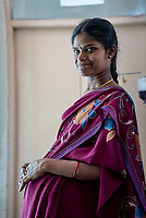A pregnant woman poses for a portrait at the Medak District Hospital in Medak, Telangana, India.