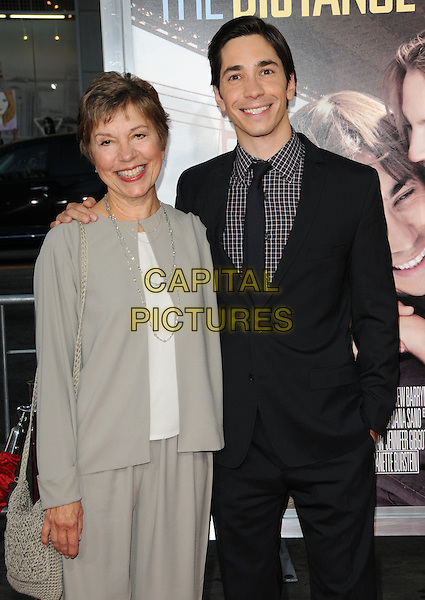 JUSTIN LONG & his mother .at the Warner Bros. Pictures' L.A. Premiere of 'Going the Distance' held at The Grauman's Chinese Theatre in Hollywood, California, USA, .August 23rd 2010..half length mum mom family  black suit tie checked check shirt  brown                                .CAP/RKE/DVS.©DVS/RockinExposures/Capital Pictures.