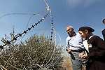 Palestinian Prime Minister Salam Fayyad attends the opening of olive harvest season in the village of Jayyous in the West Bank city of Qalqilya,11 October 2012. Photo by Mustafa Abu Dayeh