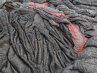 In May 2015, the only way to reach flowing lava on the Big Island of Hawaii was by a 6 mile, round trip, walk through mud which was constant on the entire hike. Sometimes 1 inch and up to mid-calf at other times. If you go, hope for clouds or rain to make the glow more vibrant during the daytime. This hike must be done with a Hawaiian guide, not on your own. The process is to find the lava flow and wait for bulges where the lava breaks out and flows. Treat Madame Pele with respect at all times.