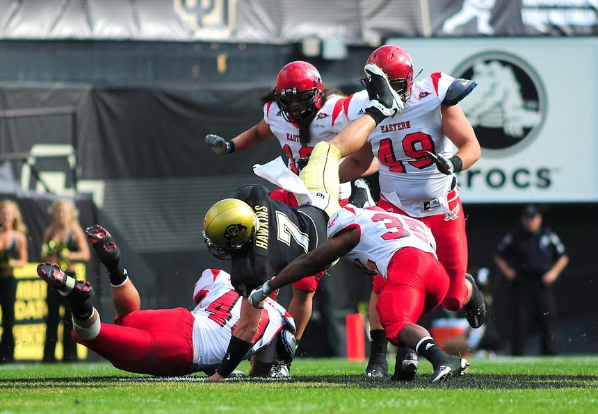 06 September 08: Colorado quarterback Cody Hawkins is surrounded by Eastern Washington defensemen on a quarterback keep play. The Colorado Buffaloes defeated the Eastern Washington Eagles 31-24 at Folsom Field in Boulder, Colorado. FOR EDITORIAL USE ONLY