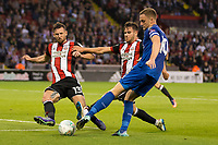 Jake Wright of Sheffield United blocks the cross of Andy King of Leicester City during the Carabao Cup match between Sheffield United and Leicester City at Bramall Lane, Sheffield, England on 22 August 2017. Photo by James Williamson / PRiME Media Images.
