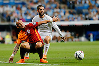 Real Madrid's Spanish midfielder Isco and Galatasaray´s midfielder Wesley Sneijder