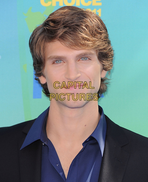 Keegan Allen.2011 Teen Choice Awards - Arrivals held at Gibson Amphitheatre, Universal City, California, USA..August 7th, 2011.headshot portrait blue black. .CAP/RKE/DVS.©DVS/RockinExposures/Capital Pictures.