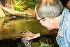 Baby Crocodile and Man at New Jersey State Aquarium