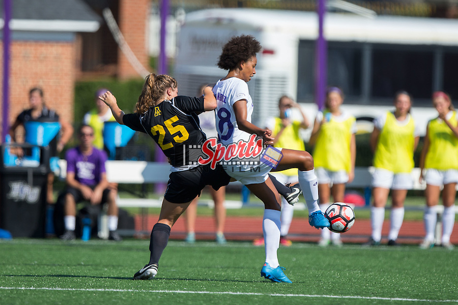 Kai-Lin Hernandez (28) of the High Point Panthers battles for the ball with Maggie Hanusek (25) of the Appalachian State Mountaineers during first half action at Vert Track, Soccer & Lacrosse Stadium on August 26, 2016 in High Point, North Carolina.  The Panthers defeated the Mountaineers 2-0.  (Brian Westerholt/Sports On Film)