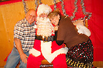 Santa Claus takes wishes from children, adults  and families alike after the Ione Business and Community Association's annual Christmas Parade in a shop on Main Street.